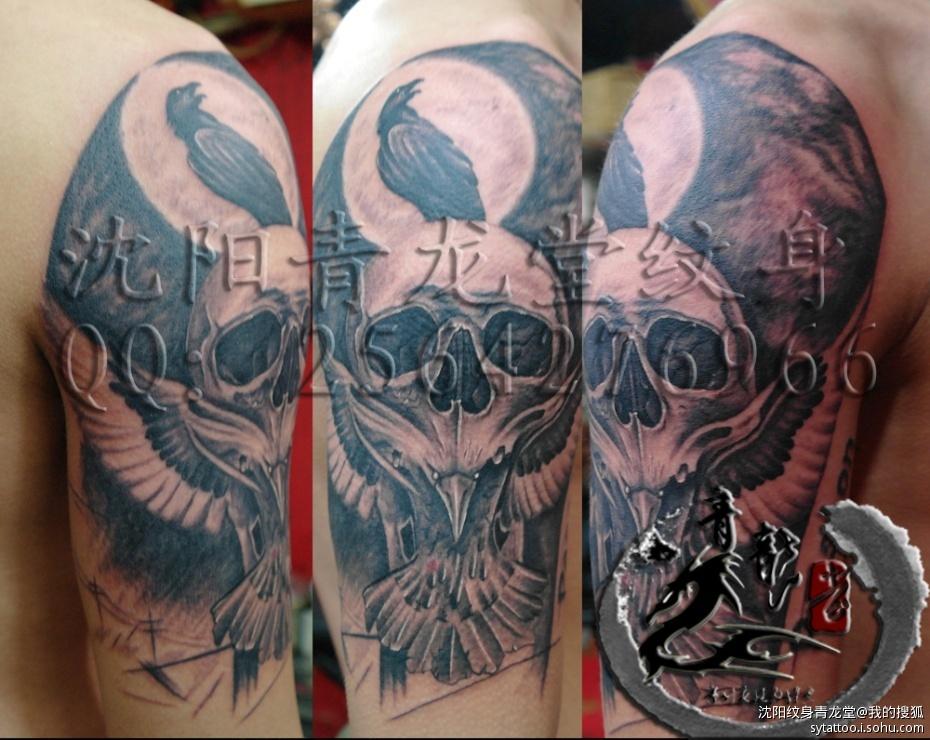 沈阳大臂骷髅鹰欧美风格纹身
